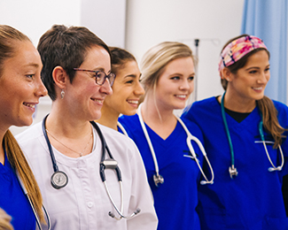 nurses with a faculty member