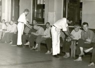 "Conscientious objectors (in white) attend to patients in the mental unit of Cleveland State Hospital during World War II. With 2,800 patients in 1945, the hospital was 600 over its capacity. ""The hospital had a poor reputation with respect to patient care,"" according to The Civilian Public Service Story at http://civilianpublicservice.org, ""Workers had to fight cockroaches and filth in overcrowded wards, and [non-CPS] attendants controlled patients by shouting and beatings. The 'incontinent and violent' wards lacked sufficient supplies or activities for patients and experienced reports of injuries to patients and employees."""