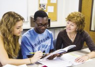 Cathy Smeltzer Erb (right), chair of EMU's undergraduate education department, confers with two education students.