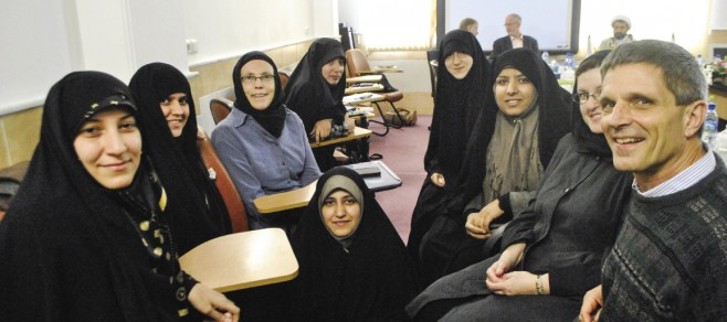 EMU leaders Daryl Byler (right) and Ann Hershberger (center wearing blue) were part of a delegation to Iran in February 2014 that met with women – all scholars at an Islamic seminary – who hope to study at EMU's Summer Peacebuilding Institute.