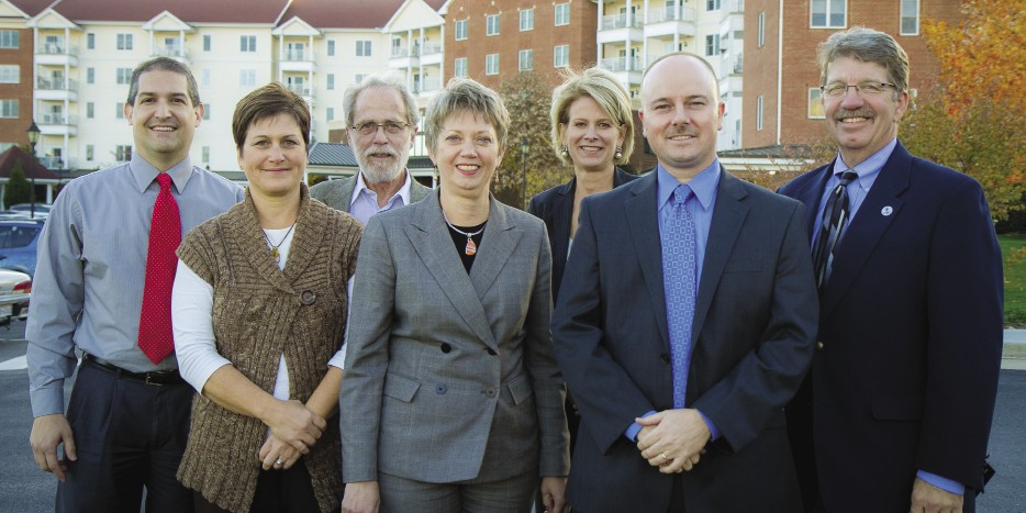 These current alumni working at Virginia Mennonite Retirement Community are standing on the shoulders of the EMU-linked persons who founded it in 1954 as the first modern retirement home in the area. From left: Mike Piper '95; Diane Weaver '91, MBA '09; Marv Nisly '68; Regina Schweitzer '78, MBA '07; Judith Trumbo '82; Shawn Printz, MBA '04; Les Helmuth '78.
