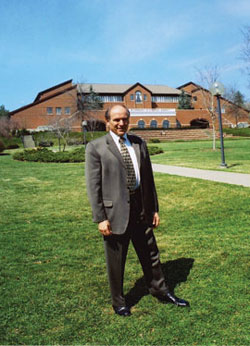 LeRoy Troyer in the winter of 2003-04 before the Campus Center, which he designed.