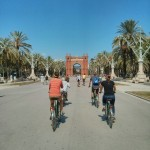 Sara, Angelina, James, and Mattie biking through Barcelona to see the city, near the Arc de Triomf. Photo by: Josh Sauder