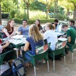 Working on homework at a local park in Granada, Spain. Sitting around the table: Holly, Michelle, McKenzie, Annika, Roberto, Alex, James, Angelina, and Becka. Photo by: Taylor Waidelich