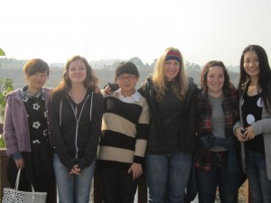 Brittany, Abby, and Emma with friends at Anqing University