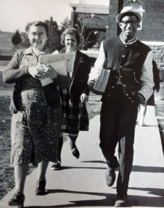 Grandison Hill walking through campus in 1963 with Northlawn residence hall in the background.