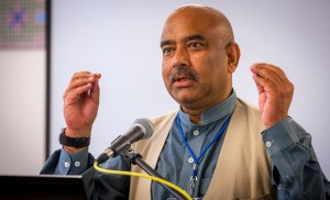 Ali Gohar addresses the audience, which included restorative justice experts and peacebuilders from around the world, after receiving the award. (Photo by Michael Sheeler)