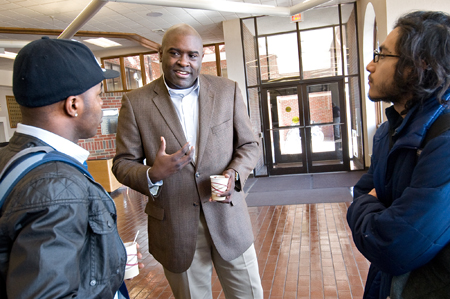 EMU alumnus the Rev. Leonard Dow (center) talks to EMU sophomores Amin Laboriel (left) and Jossimar Diaz-Castro after his talk during EMU's Spiritual Life Week.