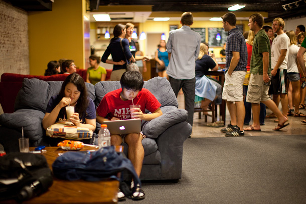 EMU students relax at the renovated and expanded Common Grounds coffeehouse, a student-run enterprise where campus concerts, forums and discussions, and other events occur throughout the semester.