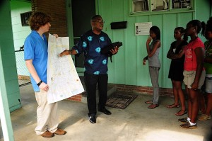 Dr. Leon Bracey speaks with students in the carport of NAACP Field Secretary Medgar Evers' home in Jackson, MS where he was gunned down in June 1963. Image, caption courtesy Karen Elliott Greisdorf.