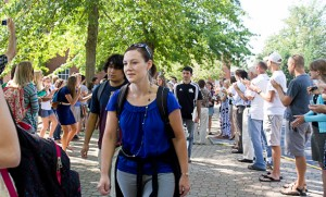"Faculty, staff and returning students line up from Lehman Auditorium to the Campus Center in a ""human tunnel"" to welcome new members to the EMU community. Photo by Jon Styer."