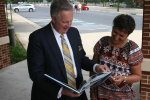 EMU President Loren Swartzendruber and Koila Costello-Olsson look appreciatively at book given to Dr. Swartzendruber by Ambassador Thompson. (Photo by Bonnie Price Lofton)