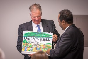 EMU President Loren Swartzendruber presents Somalia President Hassan Sheikh Mohamud with materials produced by EMU for trauma-healing work in the Somali language.