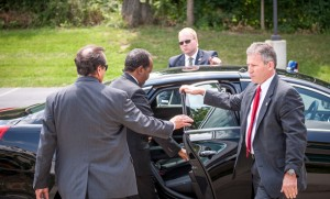 President Mohamud departs, assisted by U.S. Secret Service members.