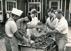 Mary Emma and others dressing chickens at the Grottoes, Va., Civilian Public Service camp.