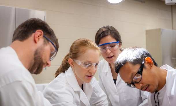 Professor Julia Halterman facilitates a cadaver dissection with MA in biomedicine students. (Photo by Michael Sheeler)