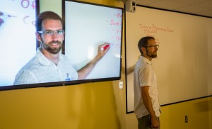 (20150819) - (Harrisonburg)  EMU Online Education Design Specialist Brian Gumm poses for a photo utilizing some of the distance learning technology available in select classrooms at Eastern Mennonite University. (Daniel Lin/Daily News-Record)