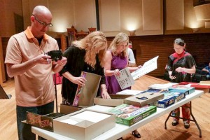 Ryan Keebaugh inspects old board games, the secret ingredient of the 2015 Iron Composer competition.
