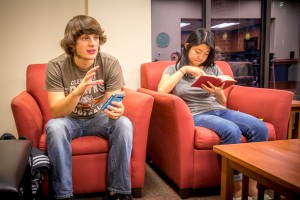 Elmwood ministry assistant Nathanael Ressler makes a point during discussion. To his left is pastoral assistant Lynn Cha.
