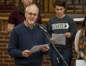 (Harrisonburg) Eastern Mennonite University campus pastor Brian Martin Burkholder leads a prayer vigil inside the Campus Center for the victims of a shooting in Hesston, Kansas. (Daniel Lin/Daily News-Record)