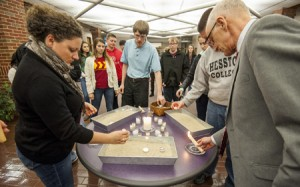 (Harrisonburg) Eastern Mennonite University students, administration, and community members light candles during a prayer vigil for the victims of a shooting in Hesston, Kansas. (Daniel Lin/Daily News-Record)
