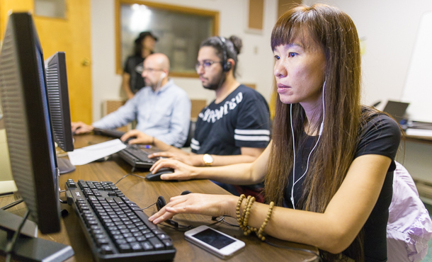 30f6b295 Jasmine Yue, Zyad Aliamani and Cesar Garcia, all students in Eastern  Mennonite University's Intensive English Program, work with recording  software on the ...