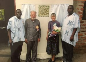 David and Grace Shenk stand outside the new Clyde Shenk school in Migori, Kenya.
