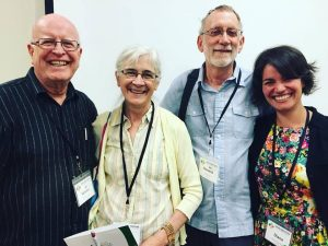 Diana Tovar with mentors and colleagues at the Center for Justice and Peacebuilding: (from left) Professor Vernon Jantzi, circles process trainer Kay Pranis, and Professor Emeritus Howard Zehr. (Courtesy photo)
