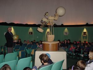 Professor Joe Mast hosts a program at the Brackbill Planetarium.