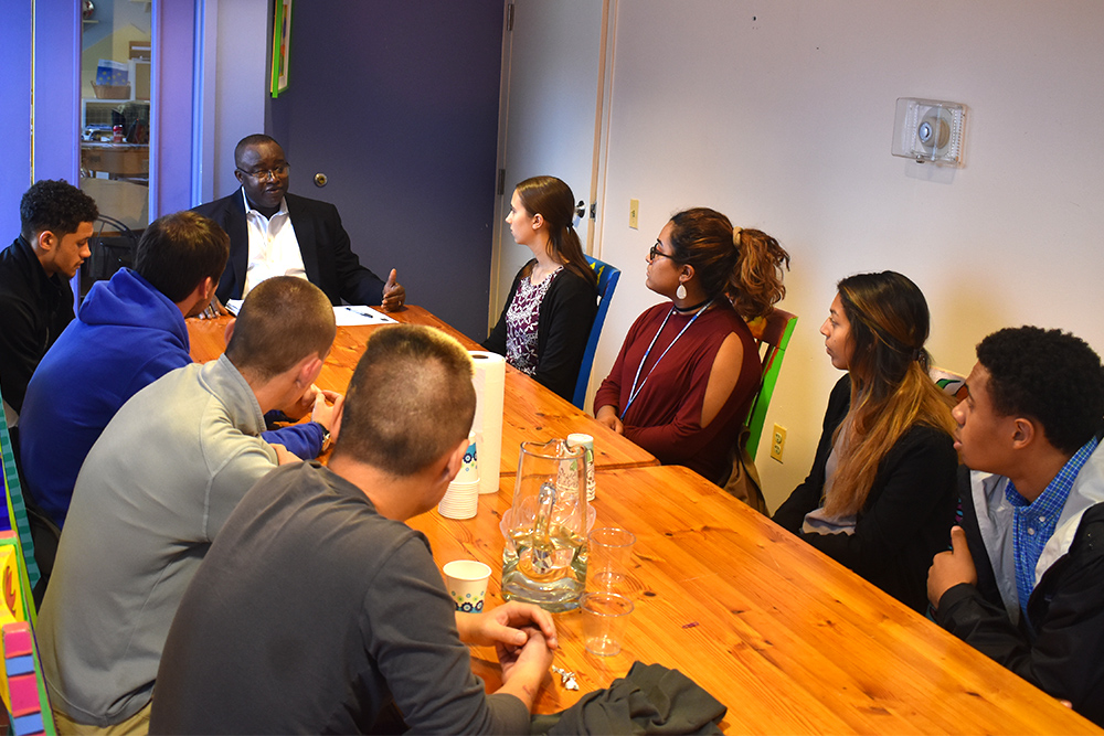 Humphrey Mensah, the chief financial and administrative officer at the Latin American Youth Center in Washington D.C., meets with business administration students from EMU