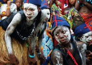 Dancers from the village of Kongonanie in Sierra Leone wait to participate in a welcome ceremony prior to the bonfire that will take place that night, as part of Fambul Tok's grass-roots reconciliation program.
