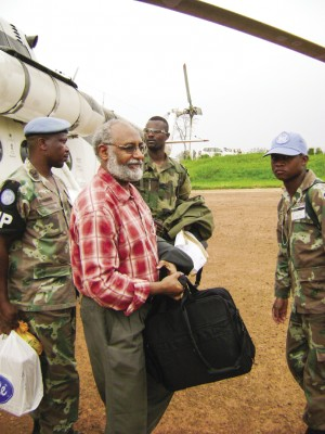 "In the company of ""Blue Berets"" – peacekeeping soldiers under the authority of the United Nations – Hizkias Assefa arrives in Ithuri in the Eastern Congo for the start of a mediation process in 2009."