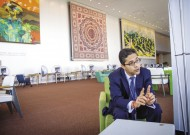 Kumar Anuraj Jha, MA '07, worked with a UN team addressing the needs of former child soldiers in Nepal before moving to UN headquarters, where he focuses on issues related to children and armed conflict in Africa. Here he is chatting in the delegate lounge on the second floor of the main UN building.