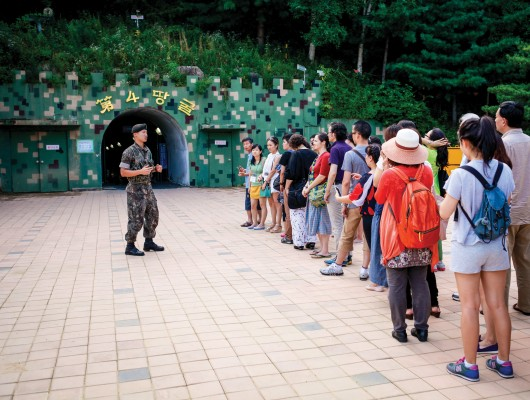 NARPI organizers reach out to military personnel, realizing that they too have their stories to tell. Here 2013 NARPI participants are visiting a site along South Korea's border with North Korea, a heavily militarized region.