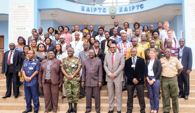 Emmanuel Bombande, MA '02 (front, fourth from right), is flanked by his successor, Chukwuemeka Eze (black jacket), and Kwesi Ahwoi, then Ghana's interior minister, at the opening of WAPI 2013 at the Kofi Annan In