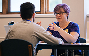 Professor Tara Kishbaugh talking with a student